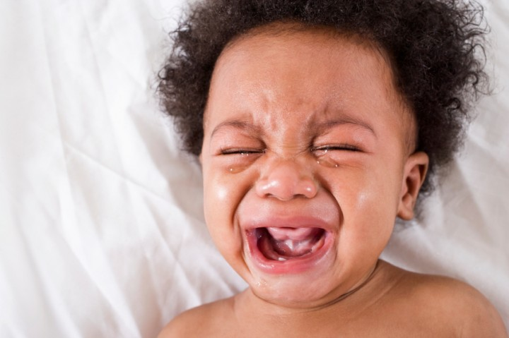 Face of crying African American baby